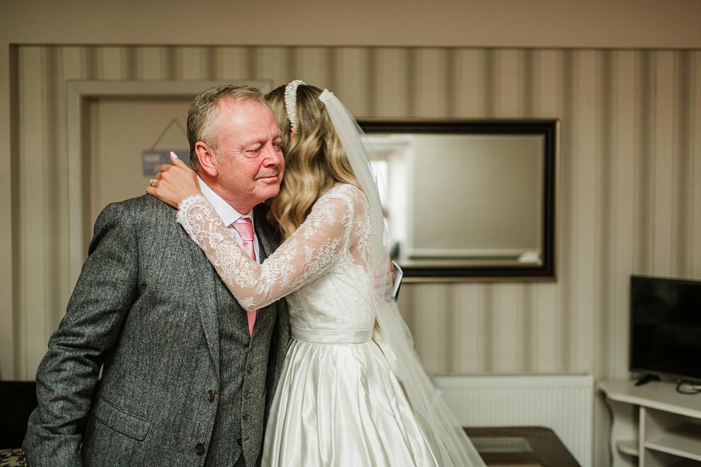 father hug bride doughter