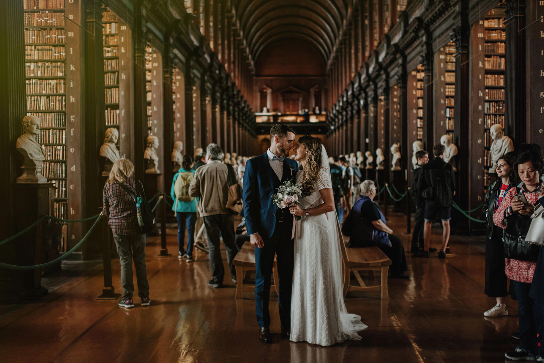 lovers looking at each other after wedding in trinity library