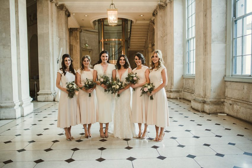 bridesmaids posing for photo inside city hall Dublin