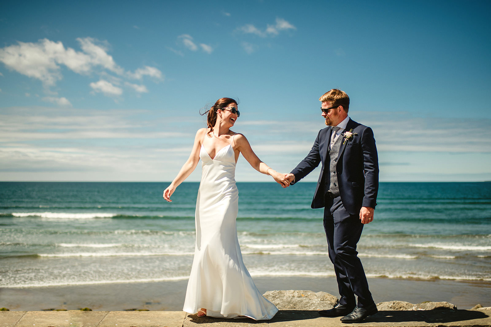 bride leading groom on strandhill beach