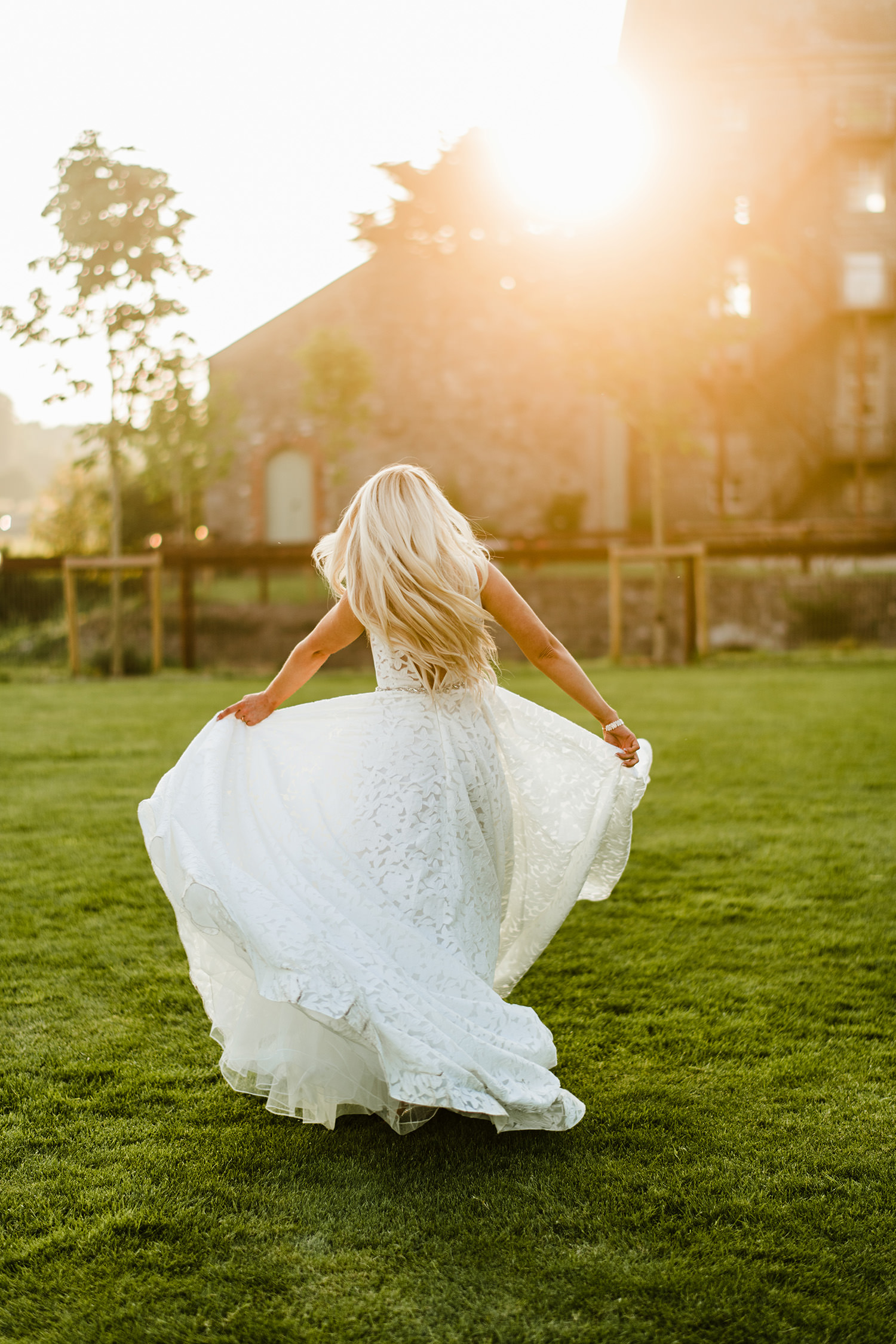 detailed wedding dress on bride dancing at lawn