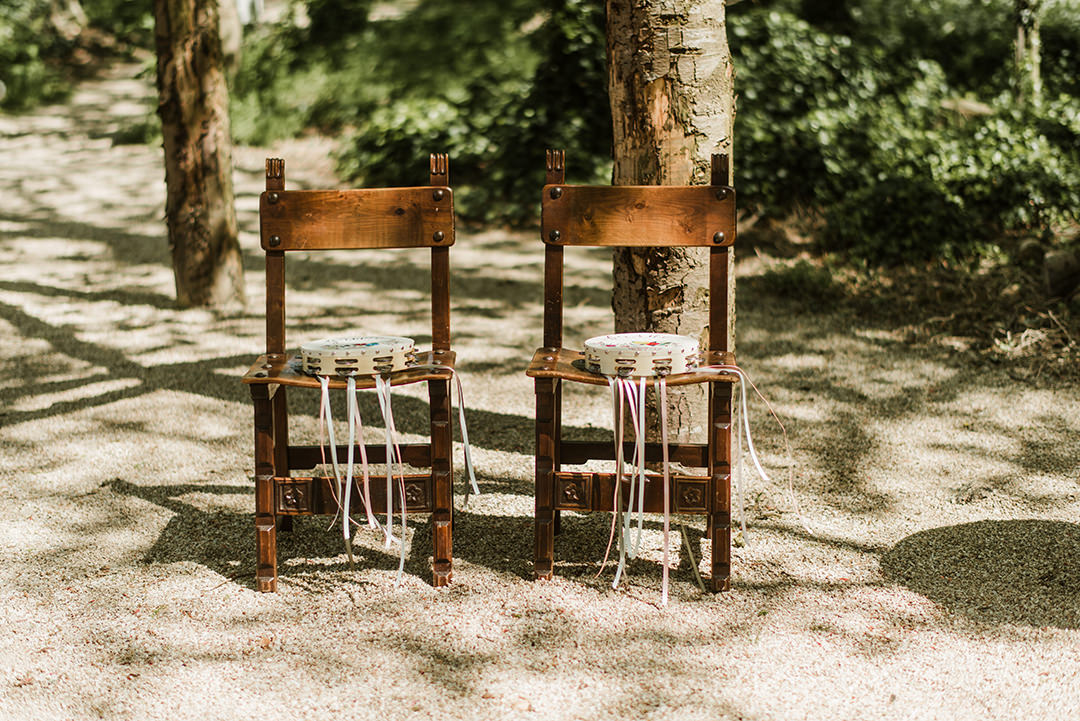 two decorated chairs at wedding ceremony