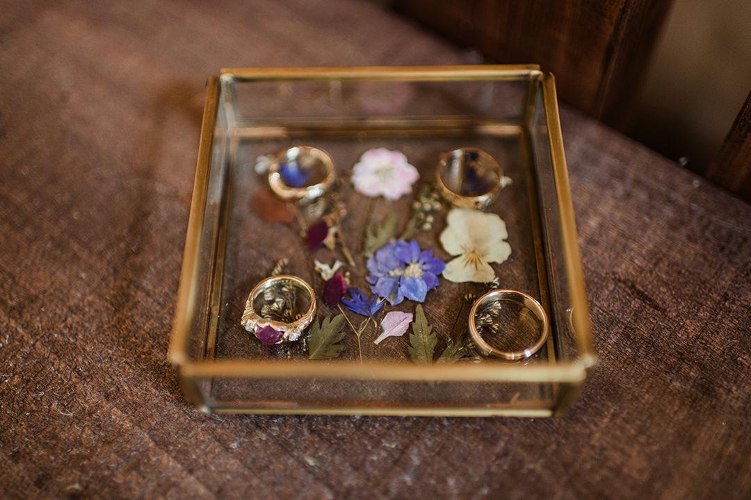 wedding rings in brass-glass box