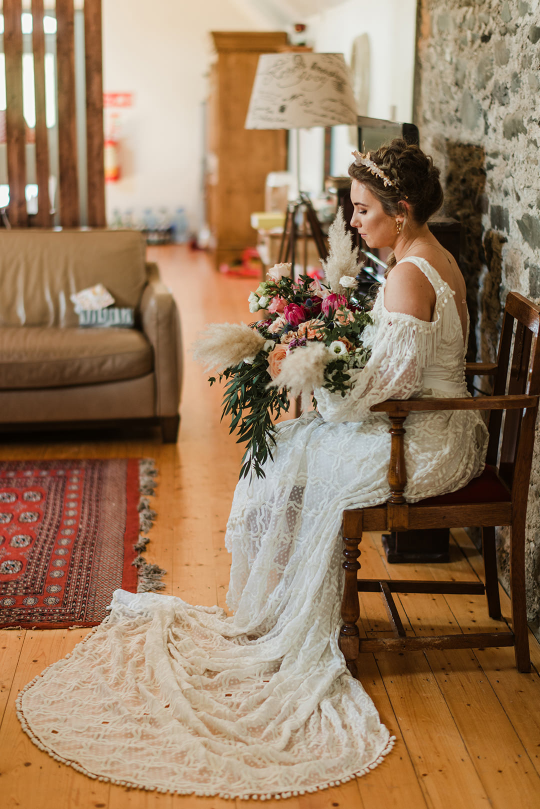 bride at chair in segrave barns