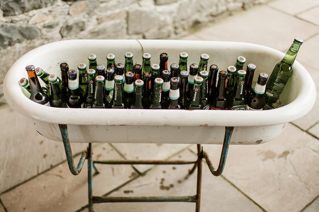 bath full of beer bottles