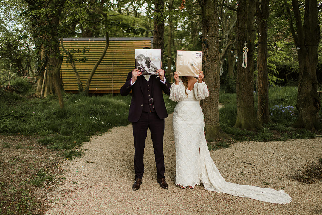 bride cover her face with vinyl record