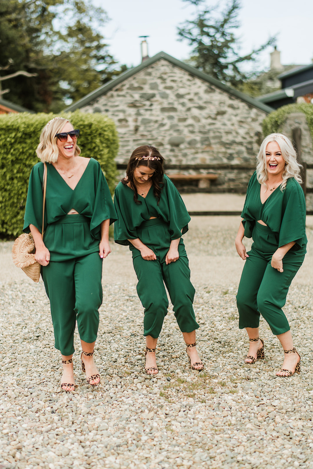 bridesmaids in gree jumpsuit