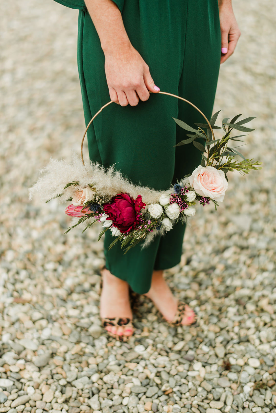 bridesmaid holding flower ring