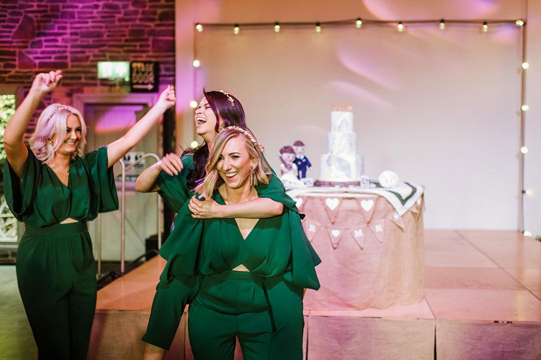 bridesmaids having fun at wedding