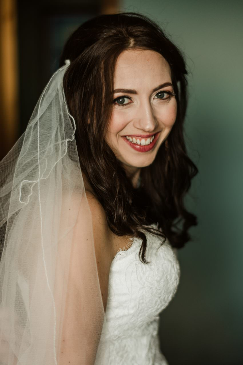 bride in white veil and hair band
