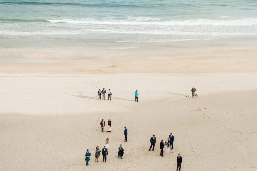 wedding guest gathering on the beach before elopement in ireland