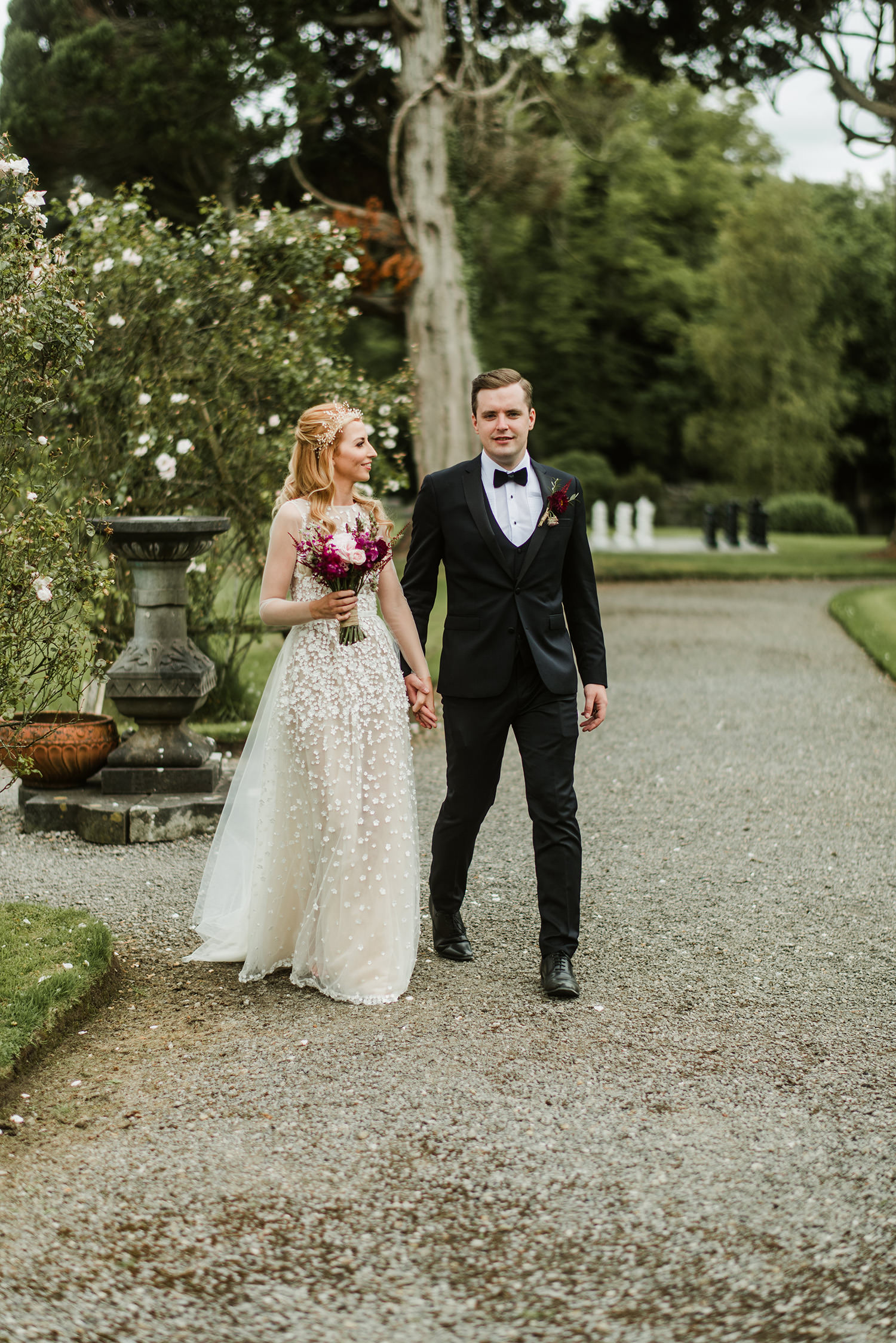 bride and groom walking on markree castle grounds