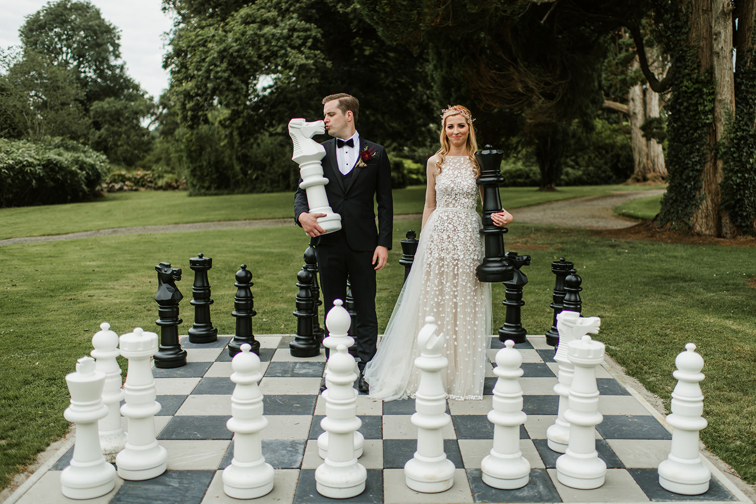 bride and groom playing chest in markree castle