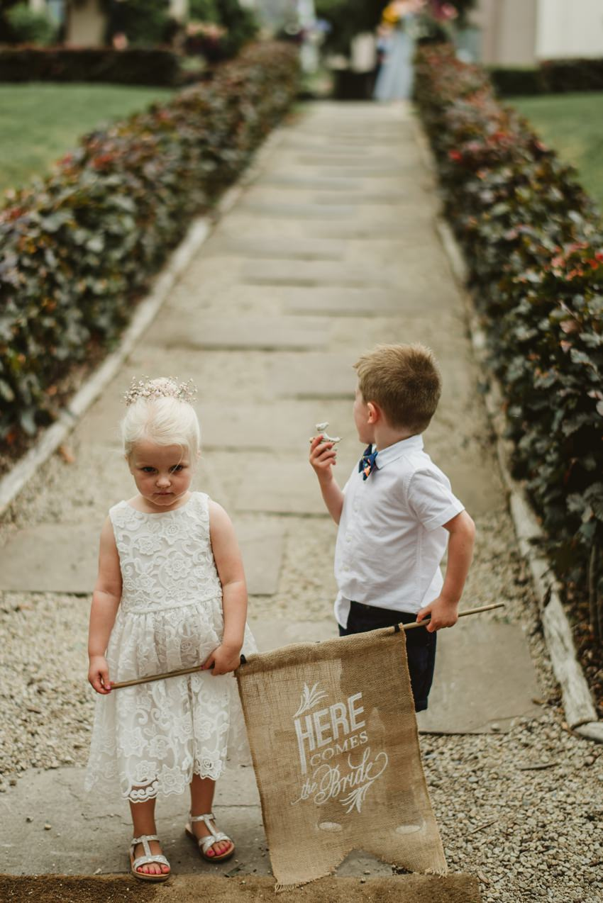 page boy and flower girl walking on the aisle