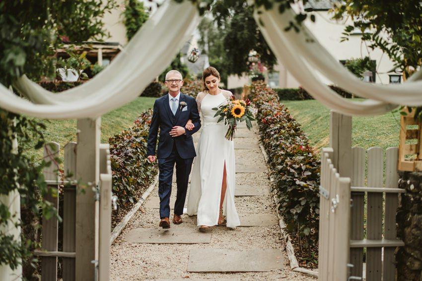 bride walk with dad for her wedding ceremony