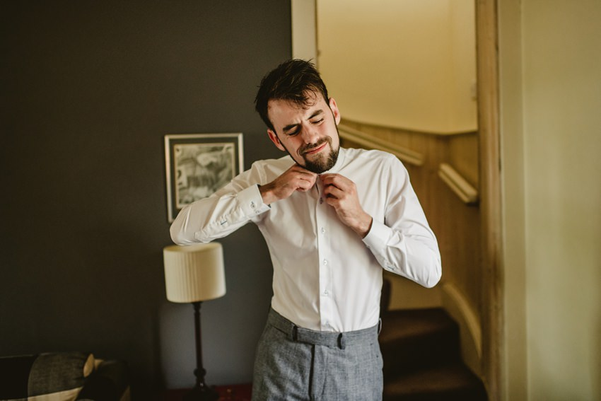 groom wearing a shirt in morning