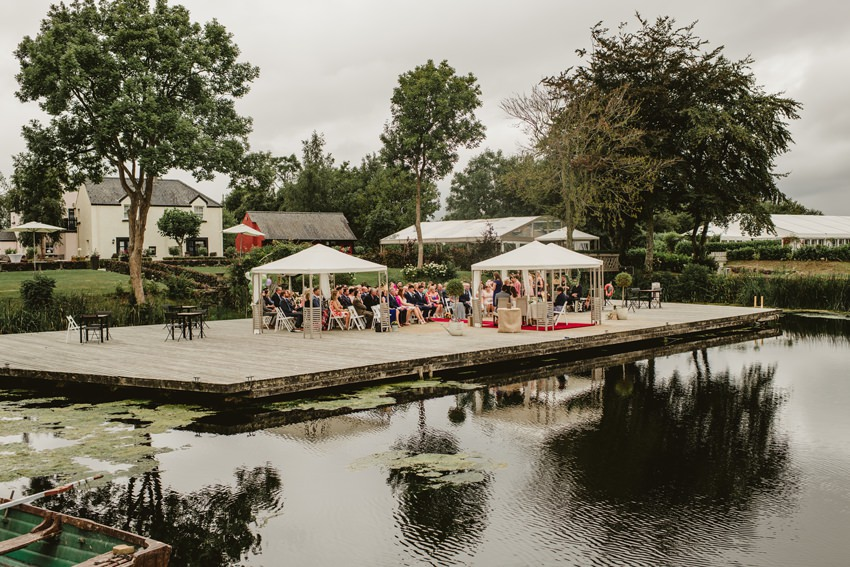 guests enjoying at drink reception by the lake