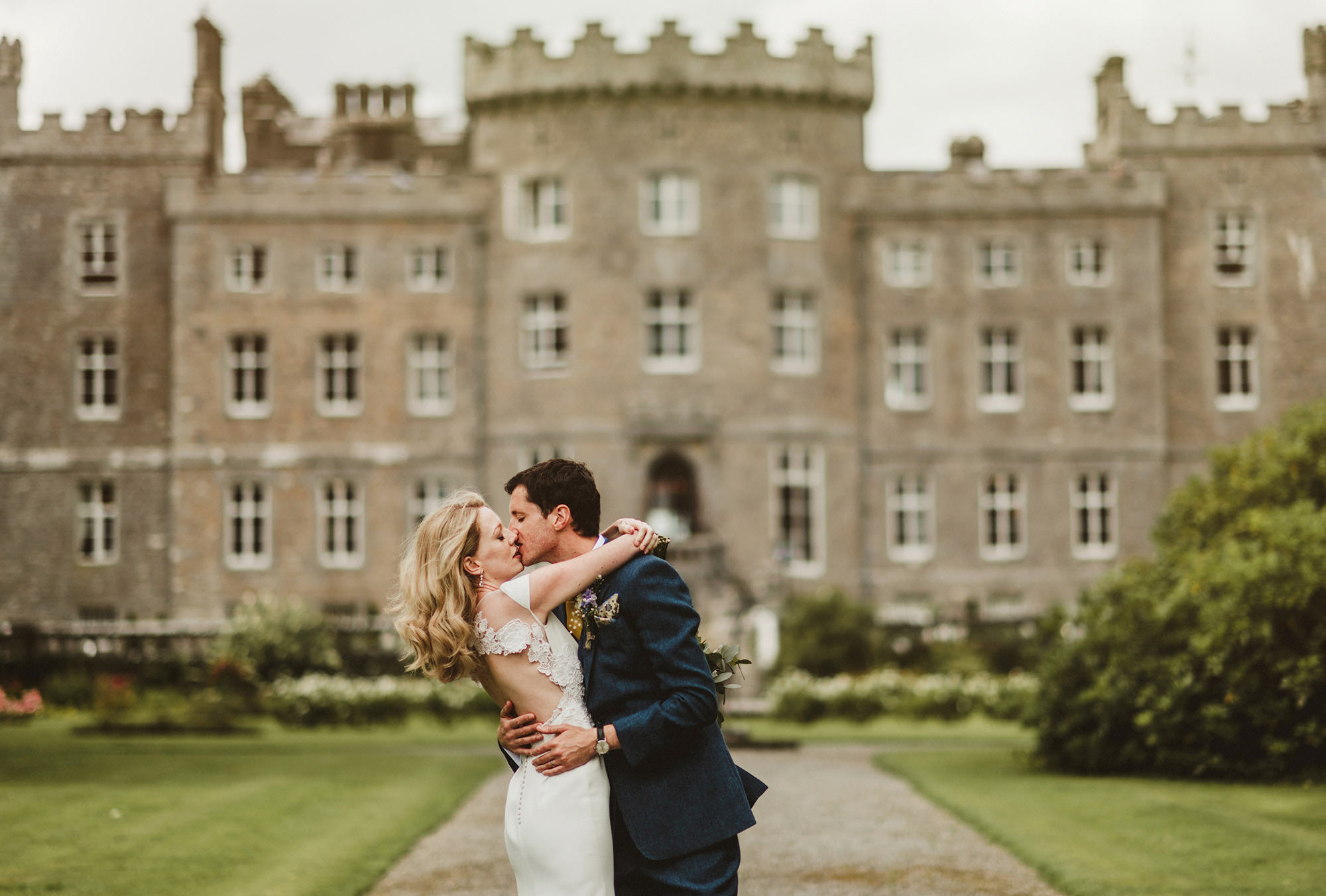 married couples kissing at front of Markree castle Co.sligo