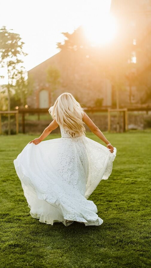 Bride in White dress dancing at sunset on wedding day in Dublin Ireland